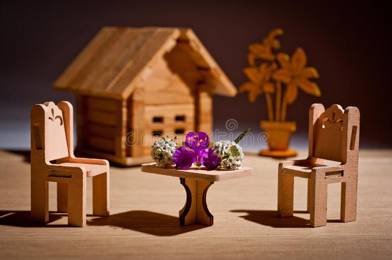 Wooden children`s toy furniture for dolls shot in the studio.  royalty free stock photography