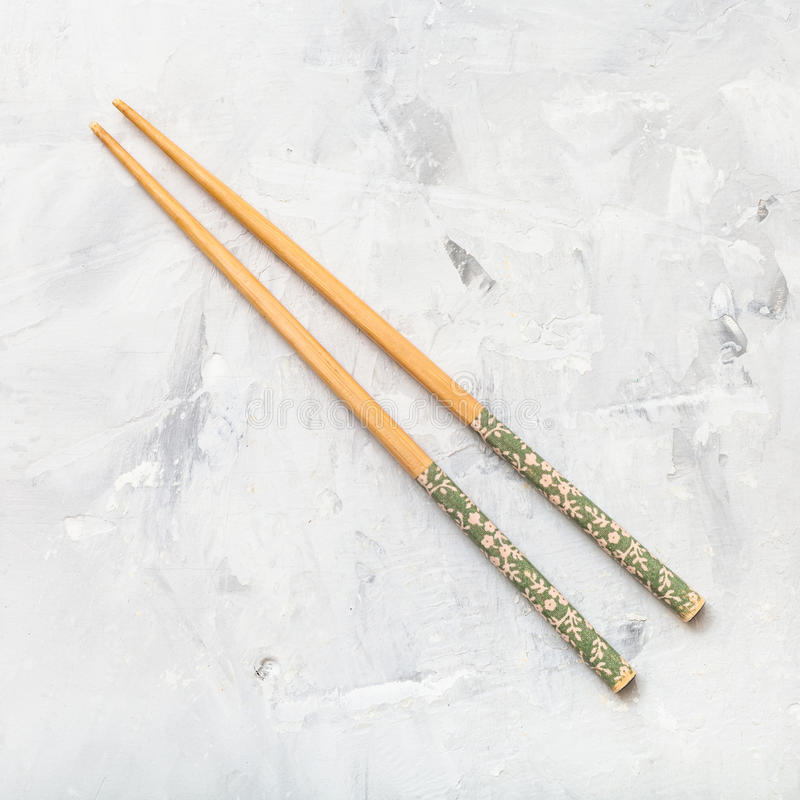 Wooden chopsticks on concrete board royalty free stock photo