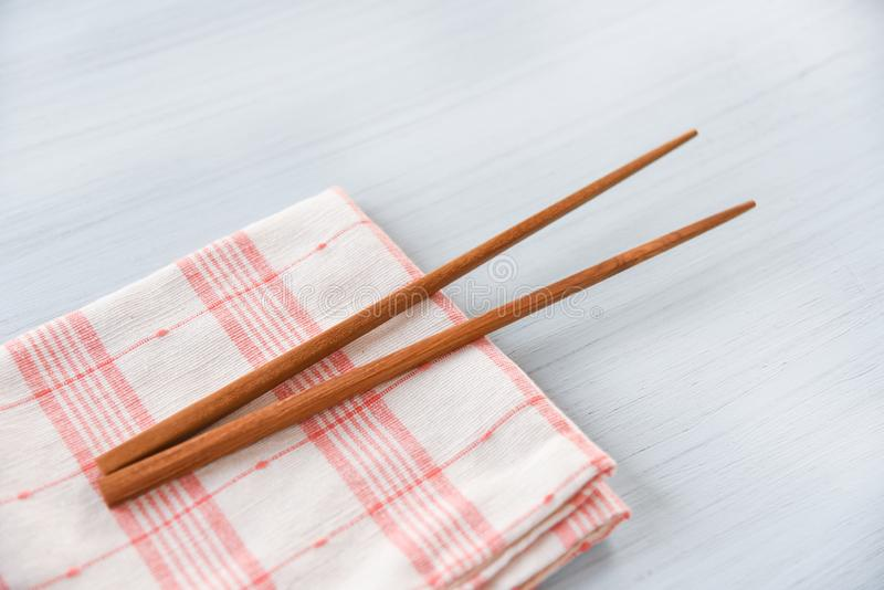 Wooden chopsticks kitchenware set on napery on dining table Zero waste use less plastic concept stock photos