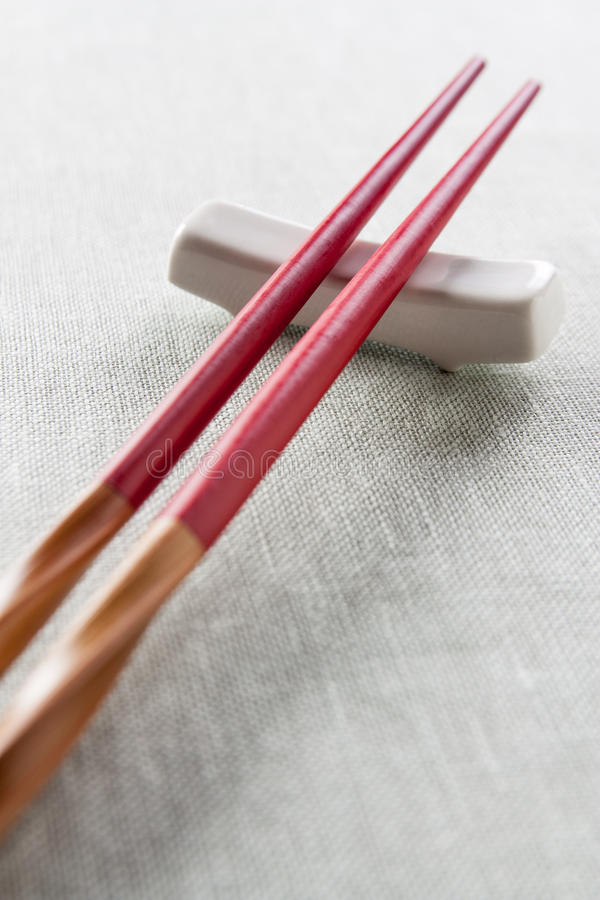 Wooden chopsticks red royalty free stock image