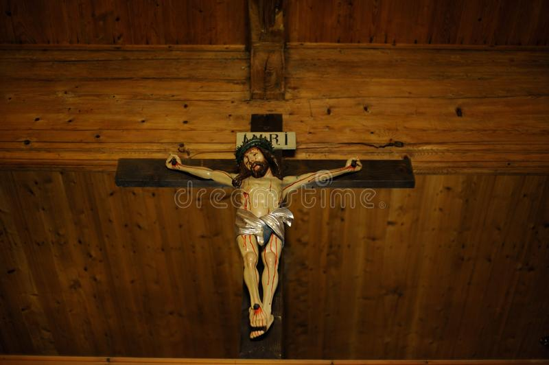 Wooden Christian cross crucifix with Jesus Christ on the cross. In southern Poland stock image
