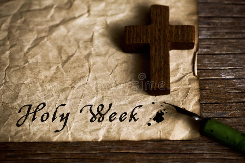 Wooden christian cross and text holy week royalty free stock photography