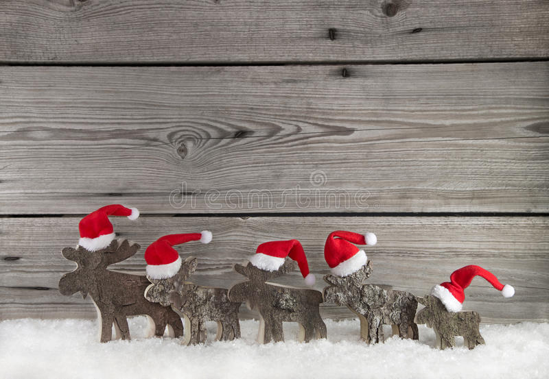 Wooden christmas background with a group of santa clause on wood. Wooden christmas background with a team of santa clause on wood for decoration stock photo