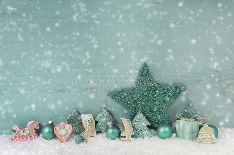 Wooden christmas background mint green with snow. stock photography