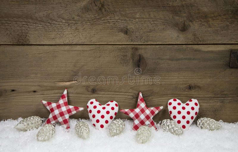Wooden christmas background with red white checked hearts and st royalty free stock images