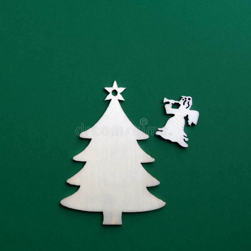 Wooden Christmas decoration on green background. Close up royalty free stock images