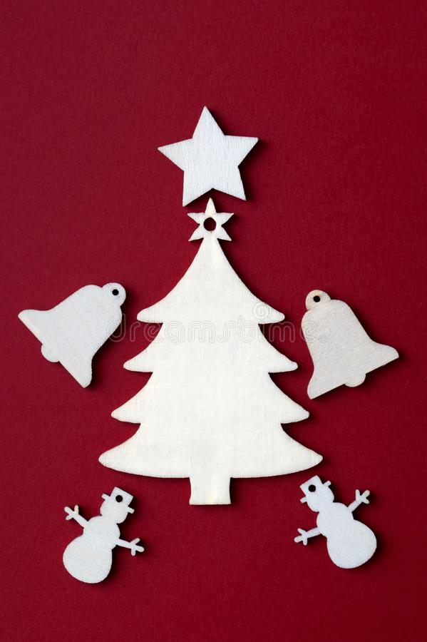 Wooden Christmas decoration on red background. Close up stock photos