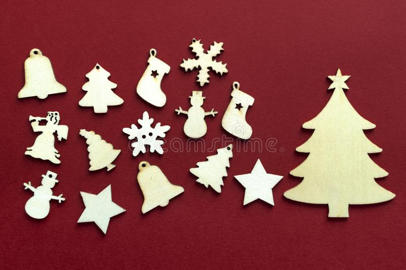 Wooden Christmas decoration on red background. Close up stock photography