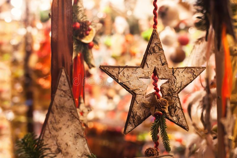 Wooden christmas star decoration close up by night stock photo