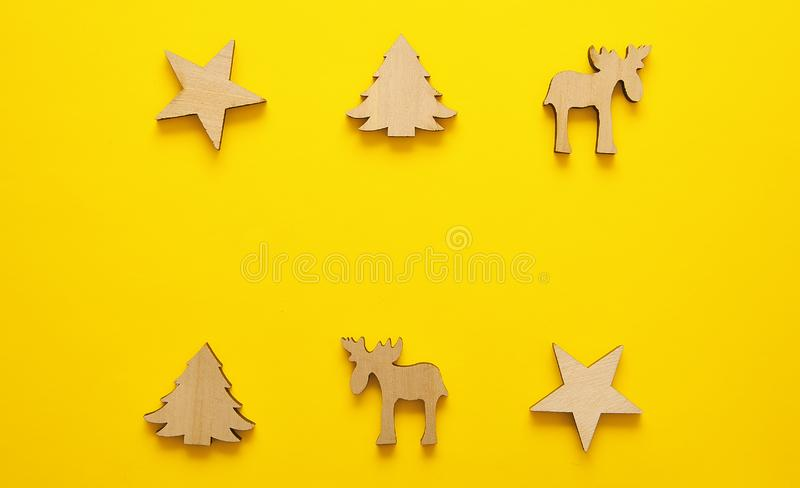 Wooden christmas toy on yellow background. Christmas background. royalty free stock images