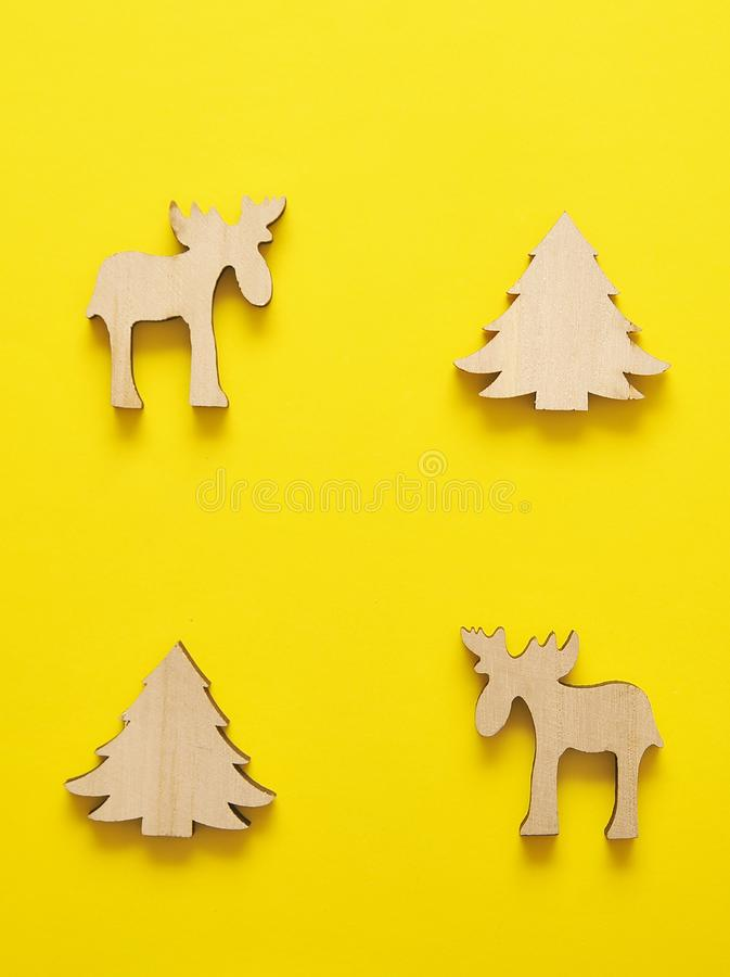Wooden christmas toy on yellow background. Christmas background. stock photography