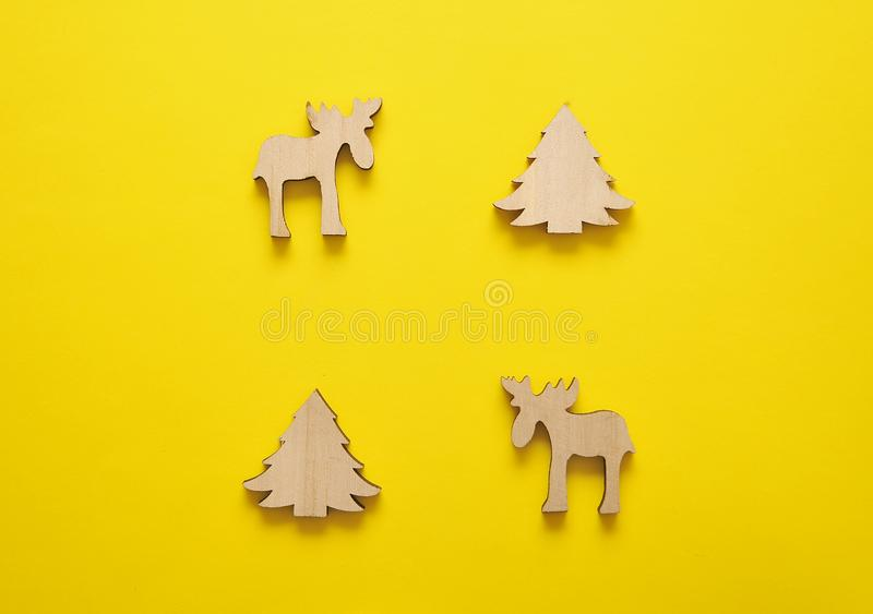 Wooden christmas toys on yellow background. Christmas background. stock photos