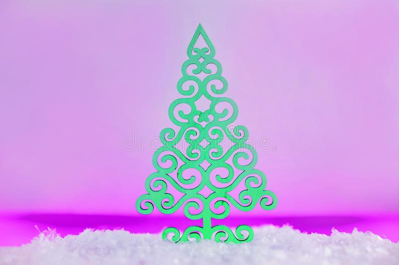 Wooden Christmas tree with artificial snow tree on pink background with copy space. Christmas tree, minimal New Year s card. Holid. Ays, Congratulation concept royalty free stock photo
