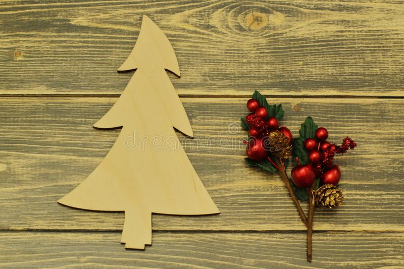 Wooden Christmas tree and Christmas decoration on dark background. Vintage stock images
