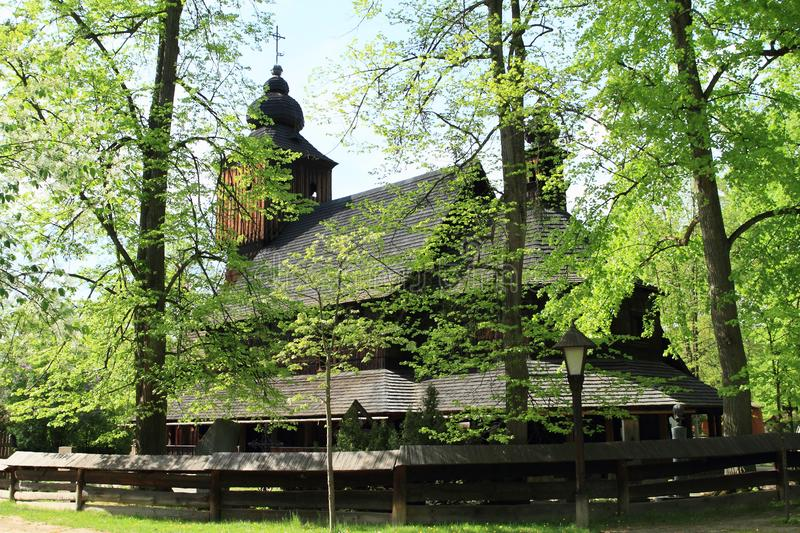 Wooden church of Anna from Vetrkovice behind trees stock images