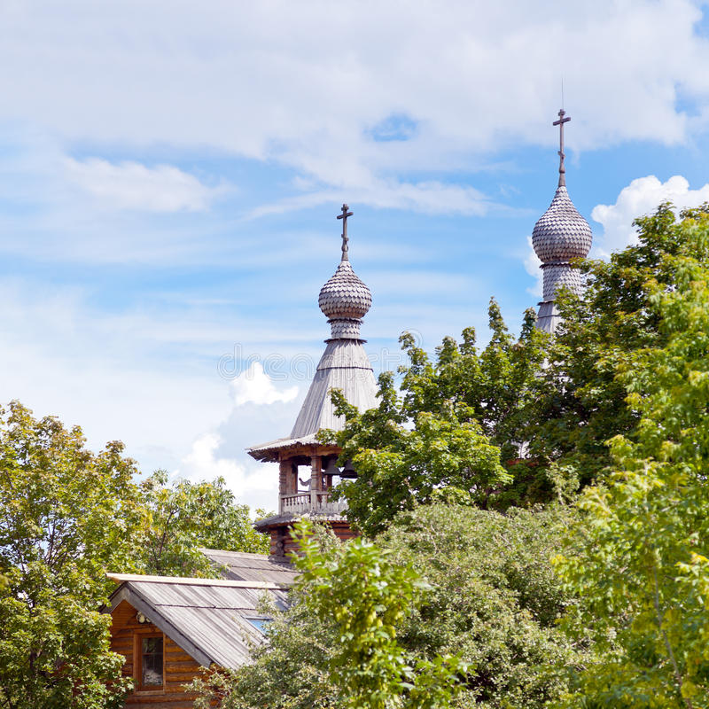 Wooden church in green garden royalty free stock images