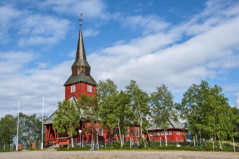 Wooden church in Kautokeino village in Norwegian Finnmark. The birch trees are around the church buildings royalty free stock photo