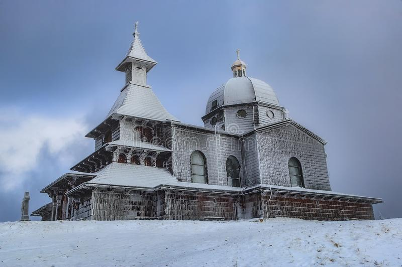 Wooden church in winter stock images