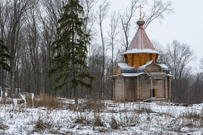 A wooden church under construction in a monastery in Russia royalty free stock images