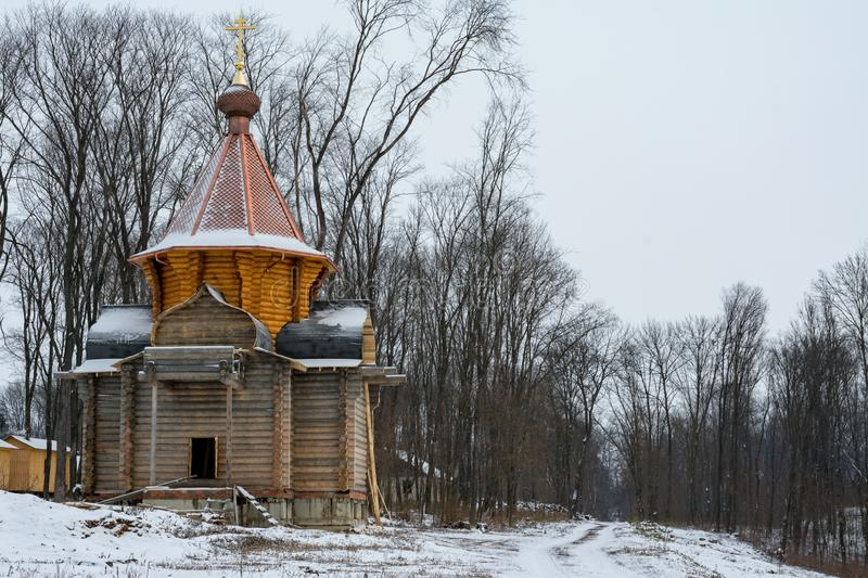 A wooden church under construction in a monastery in Russia stock photography