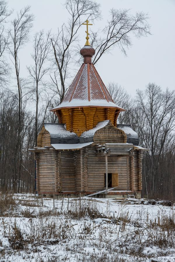 A wooden church under construction in a monastery in Russia stock images