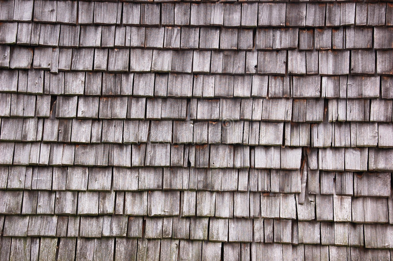 Wooden clapboard. On an ancient house wall royalty free stock images