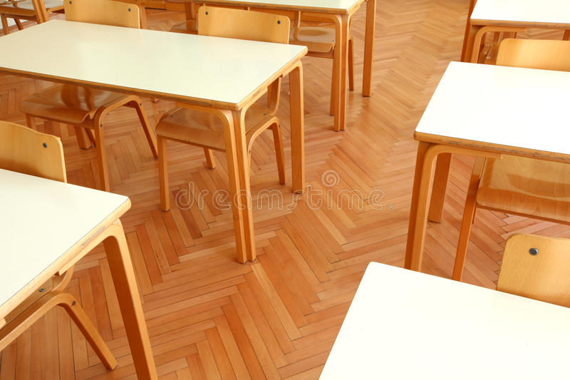 Wooden classroom tables and chairs royalty free stock