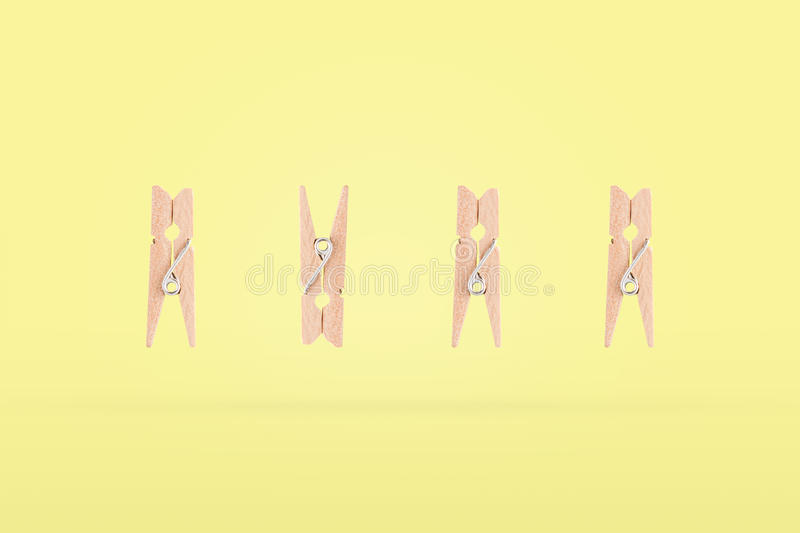 Wooden clip is called a row and is different from one row. The concept is differently harmonized in the object. A wooden clip is called a row and is different royalty free stock photos