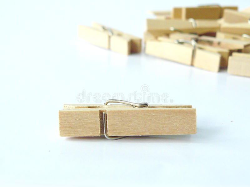 Wooden clip. Pile of small wooden clip or wooden clothespins on white background stock photography