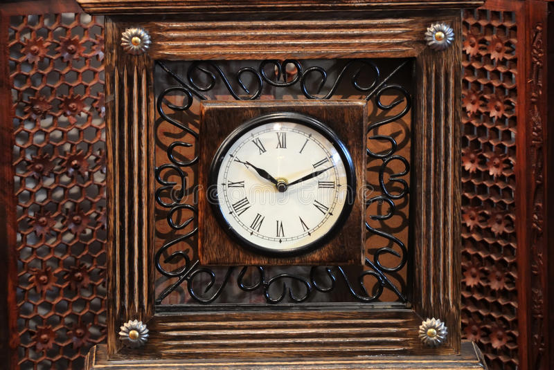 Wooden clock royalty free stock photography