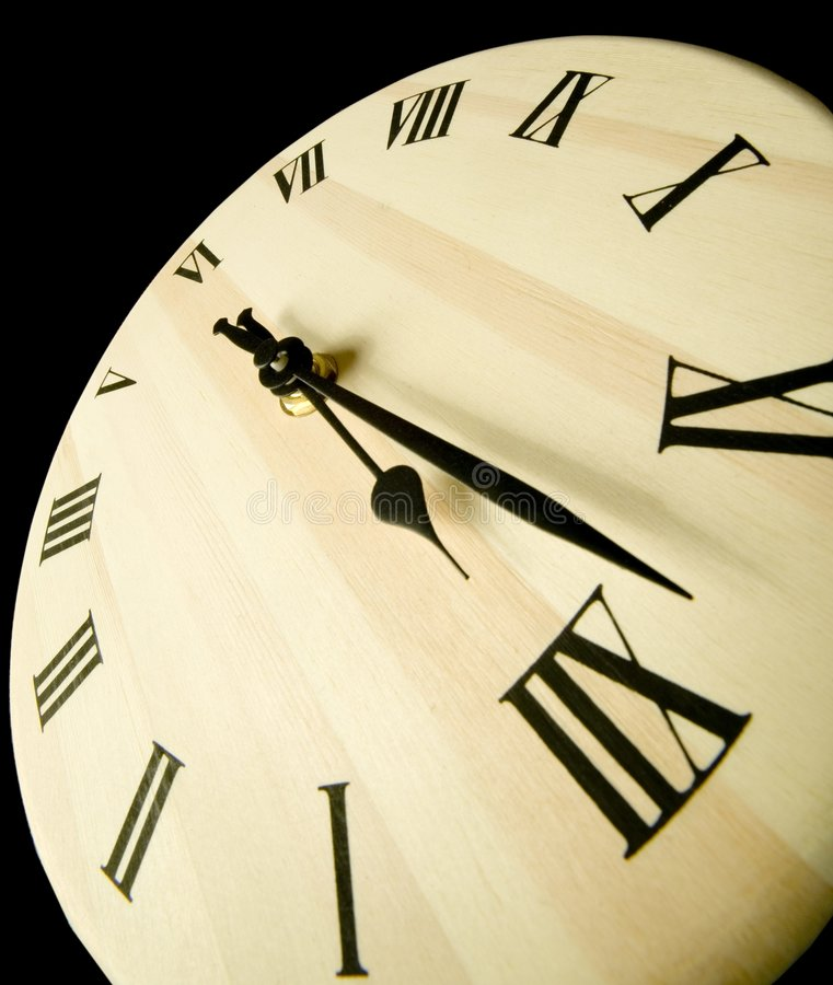 Wooden clock. On black royalty free stock image