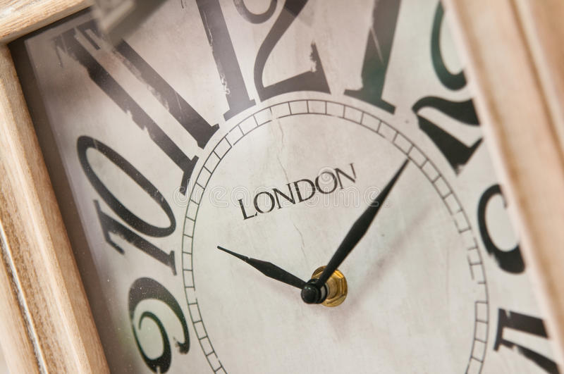 Wooden clockface with London inscription royalty free stock photos