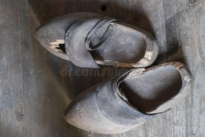 Wooden clogs for the countryside. Antique Wooden Shoes stock images