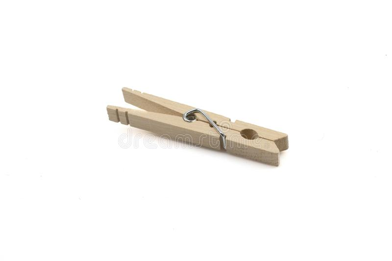A wooden clothes pin on a white background stock image