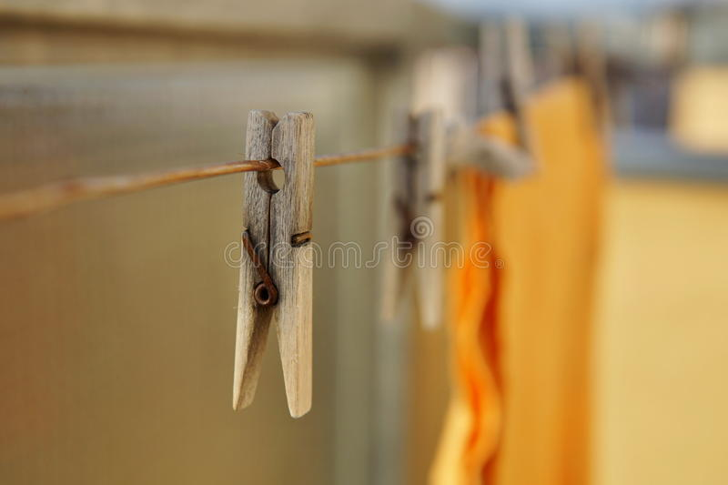 Wooden Clothespin Peg Hanging On The Balcony String As A Symbol Of