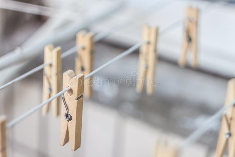 Wooden clothespins on a clothesline, blur, light photo. The concept of eco-consumption, the use of natural materials, awareness royalty free stock photography