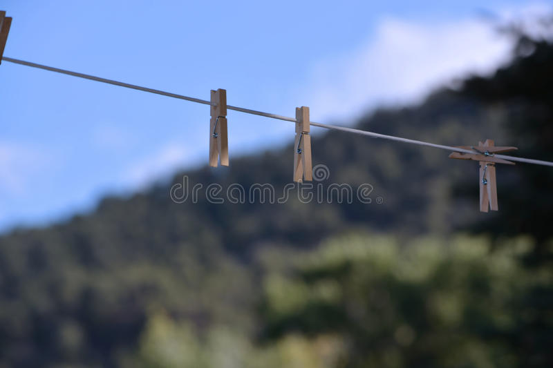 Wooden Clothespins on Clothesline stock images