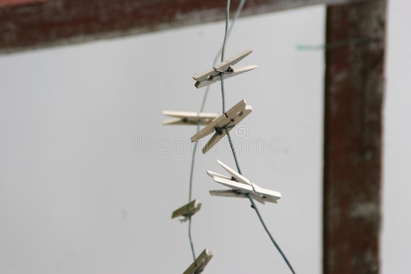Wooden clothespins on a clothesline stock photography