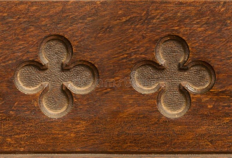 Wooden cloverleaf shaped indent pattern seamlessly tileable. Indented wooden cloverleaf shaped pattern seamlessly tileable stock image