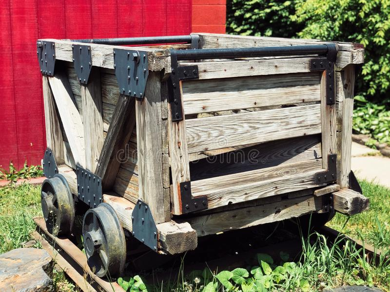 A wooden coal cart inside The No.9 Coal Mine museum royalty free stock photo