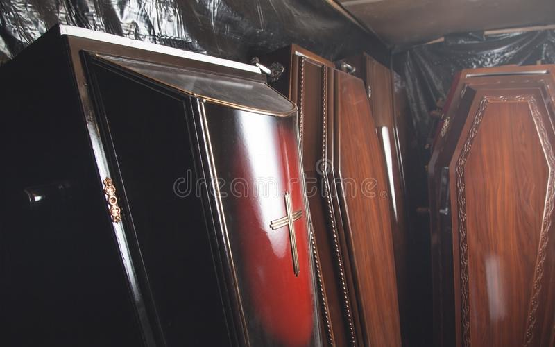 Wooden coffins in the dark room stock images