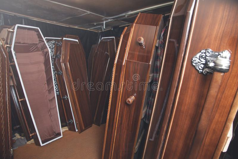 Wooden coffins in the dark room stock photography