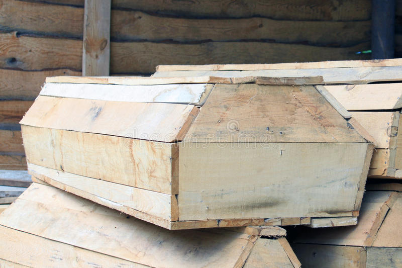 Wooden coffins in stock. Close up royalty free stock photography
