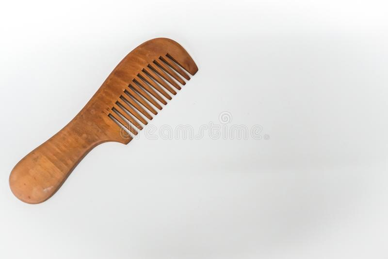 Wooden comb for woman hair and beauty stock images