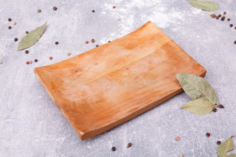 A wooden concave board on the table royalty free stock photography