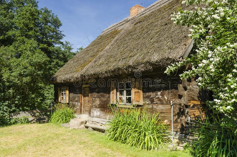 Wooden cottage on a farm stock photography