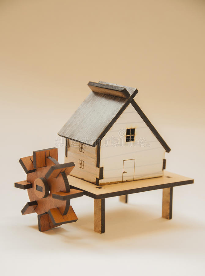 Wooden cottage with mill water royalty free stock photos
