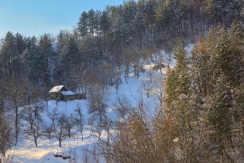 Wooden Cottage in Winter Landscape royalty free stock photos