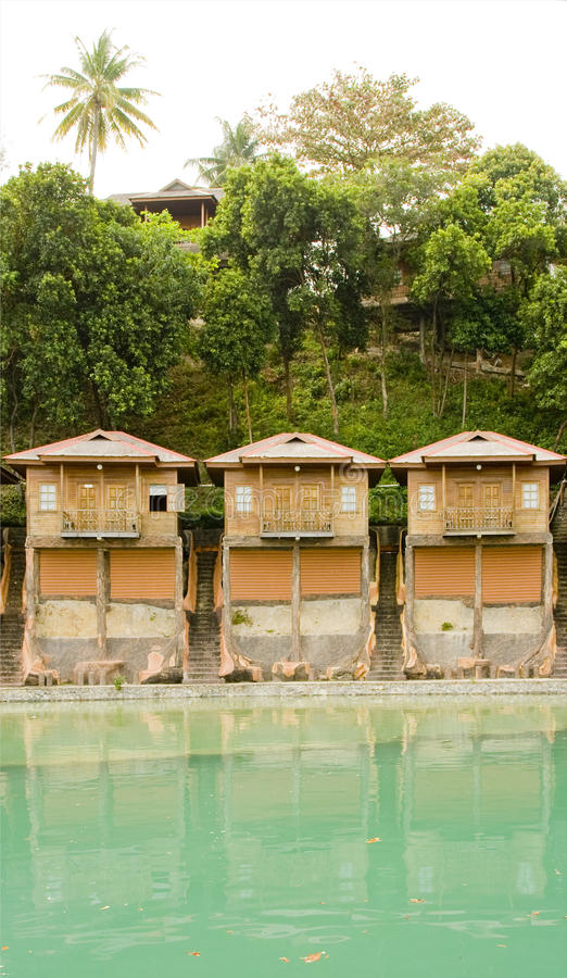 Wooden cottages. Holiday chalets by the sea, Batam, Indonesia royalty free stock images