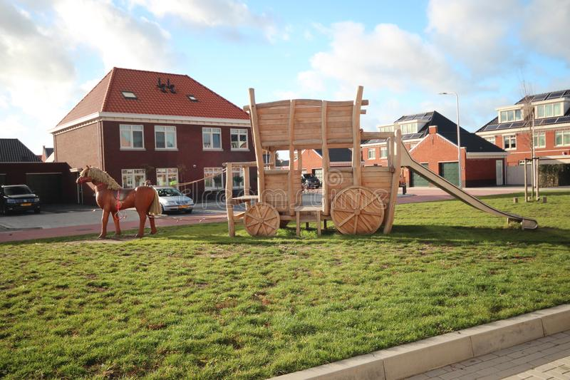 Wooden couch and horse in public playground in the Koetsierstuin in the Koningswartier district in Zevenhuizen. royalty free stock photo